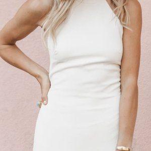 Modern, chic, minimalist never-worn wedding dress